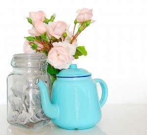 beautiful teapot with flowers and tea bags
